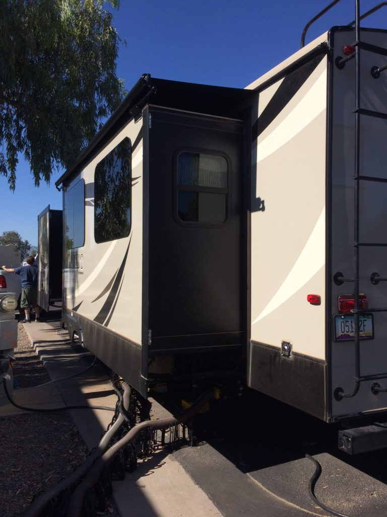 The vew from the rear of our trailer, with the slide out and the awning installed.