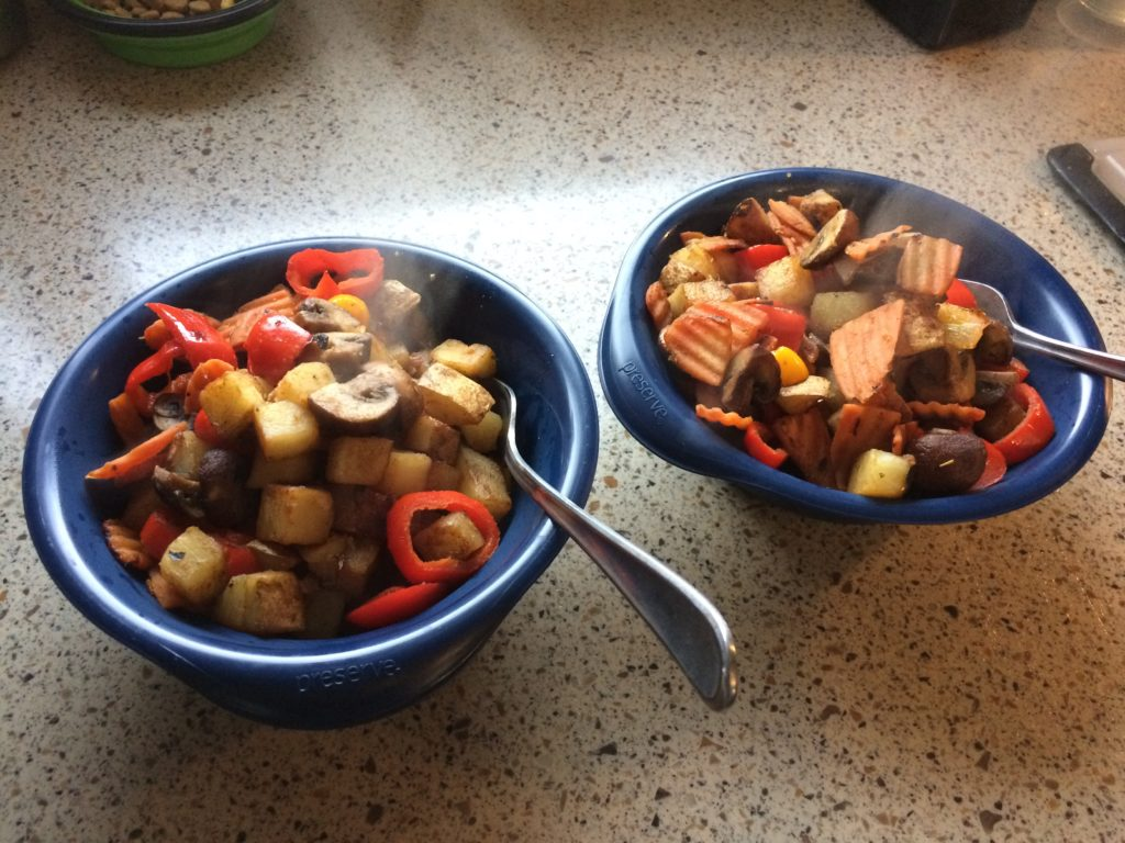 Two bowls of a mixed vegetable hash