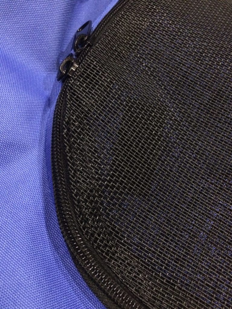 Closeup of the finished repair with new screen attached to the existing zipper.