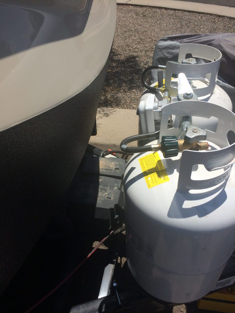 view of the side of two LP gas tanks with the regulator mounted backwards