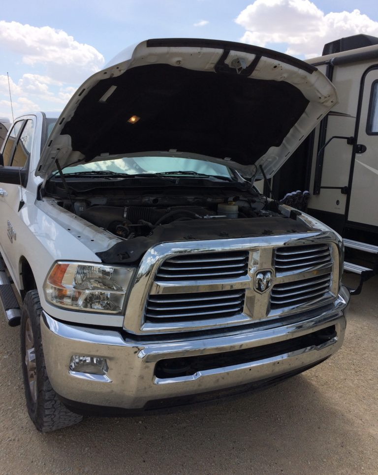 A pickup truck with its hood open