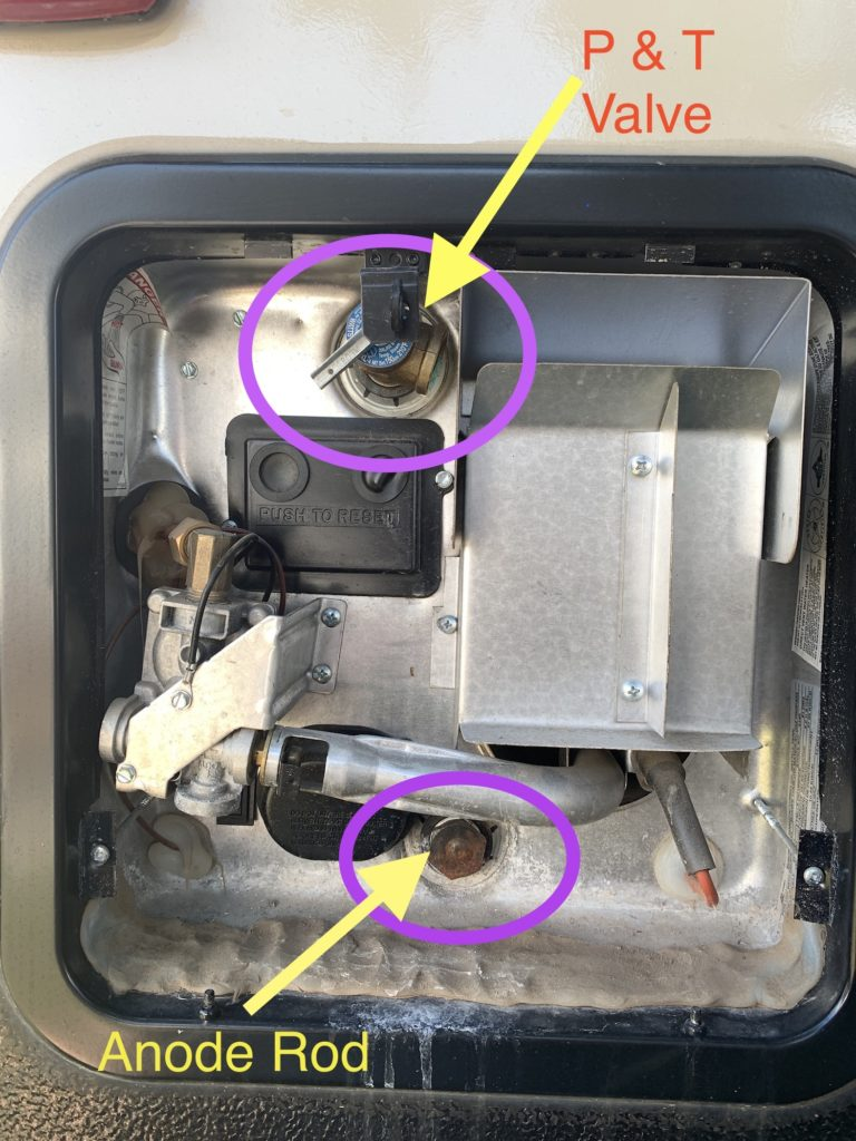 View of the combustion chamber of the hot water tank with the P&T valve and anode rod highlighted and identified