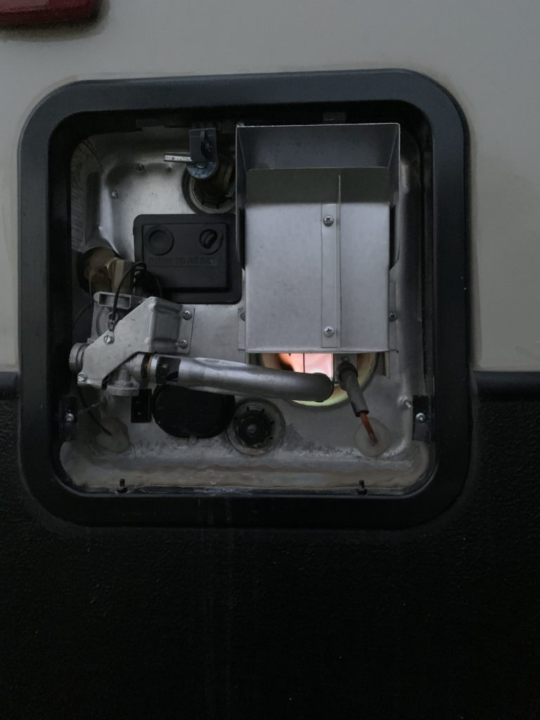 View of the water heater with the LP gas burner on