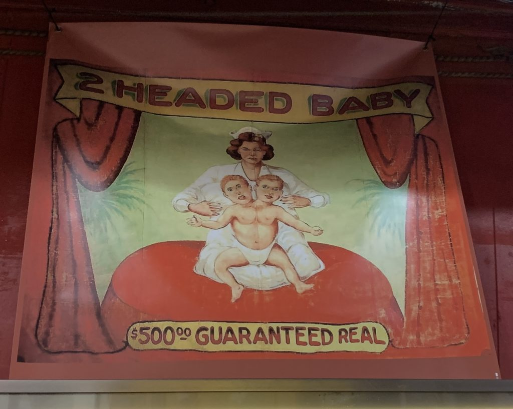 A sign for the two-headed baby, with a $500 guarantee of authenticity.