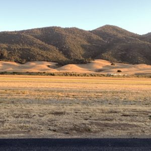 rolling mountains across a field