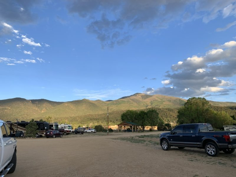 photo of an RV park, with very few RVs and lots of blue skies.