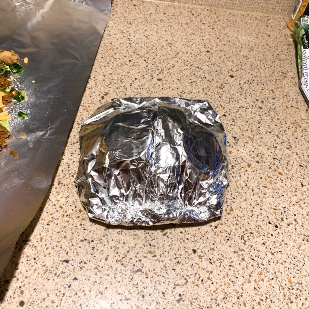 A fully wrapped foil packet ready for the grill