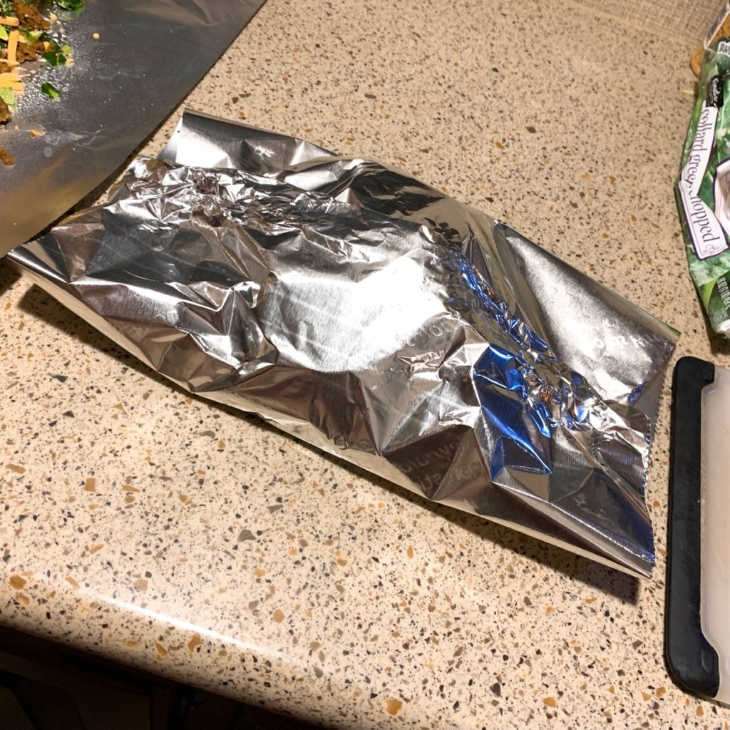 Foil closed on one direction over food, with two open ends