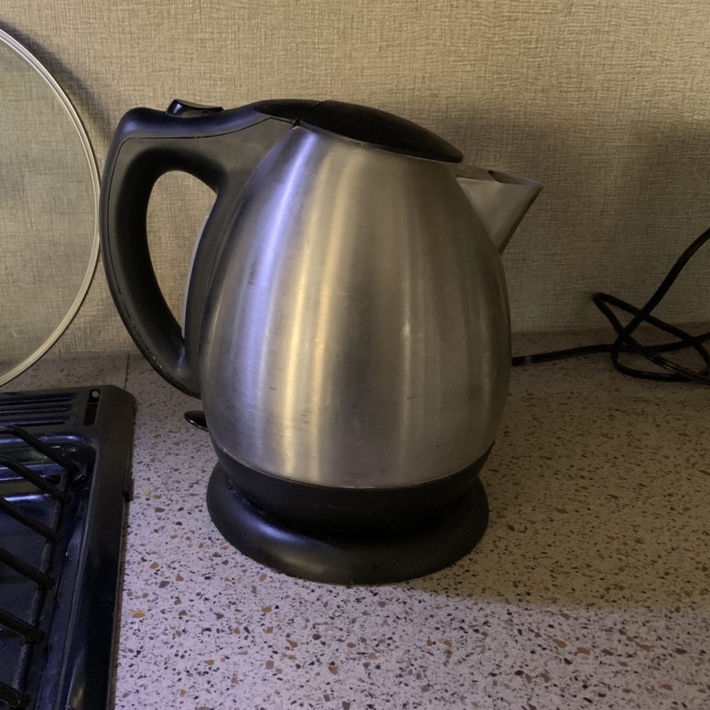 an electric kettle on a counter.