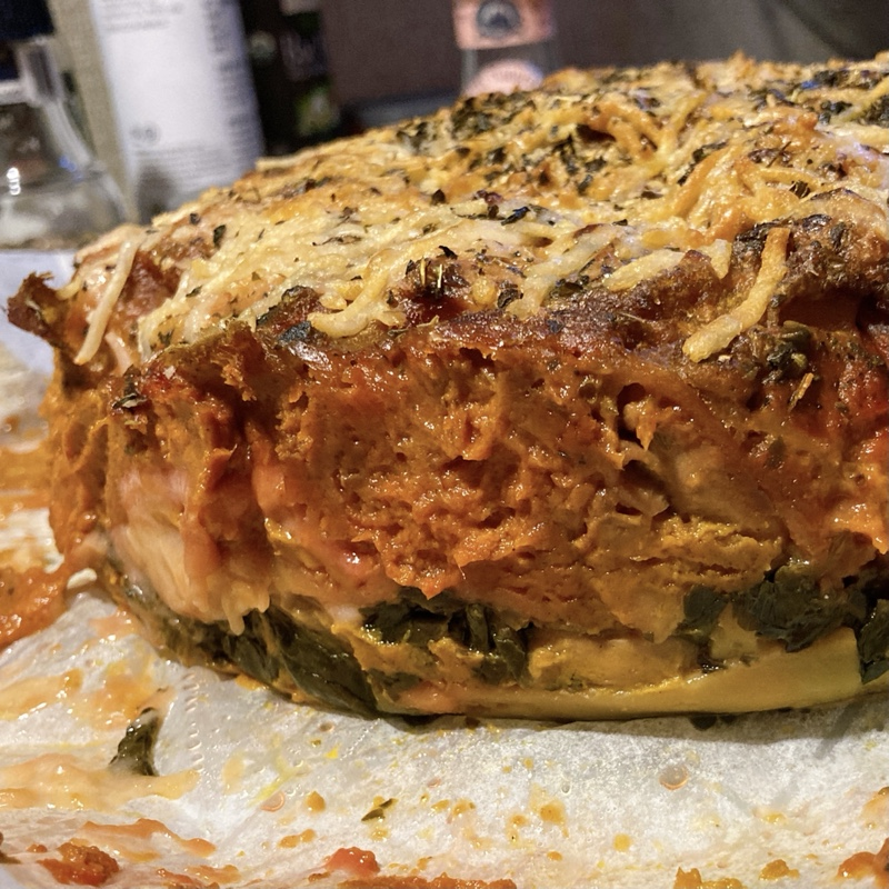 an entire cooked lasagna, out of the pan